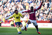 Aston Villa defender (on loan from Wolverhampton Wanderers) Kortney Hause (30) comes in to block a shot from Blackburn Rovers midfielder Bradley Dack (23) during the EFL Sky Bet Championship match between Aston Villa and Blackburn Rovers at Villa Park, Birmingham, England on 30 March 2019.