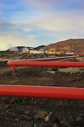 Large pipes transport nearly boiling water away from the Svartsengi Power Plant in southwest Iceland. It is one of five major plants in Iceland that convert geothermal energy from volcanic sources to hot water or electricity. This plant produces 76.5 MW of electricity, and about 475 litres/second of 90 °C hot water. Excess hot water is used in the Blue Lagoon (Bláa Lónið).