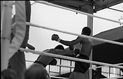 Ali vs Lewis Fight, Croke Park,Dublin.<br /> 1972.<br /> 19.07.1972.<br /> 07.19.1972.<br /> 19th July 1972.<br /> As part of his built up for a World Championship attempt against the current champion, 'Smokin' Joe Frazier,Muhammad Ali fought Al 'Blue' Lewis at Croke Park,Dublin,Ireland. Muhammad Ali won the fight with a TKO when the fight was stopped in the eleventh round.<br /> <br /> Picture of Ali as he sends Lewis on to the defensive.