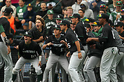 De La Salle infield Michael Reuling (15), left, is celebrated after a 2-run homer during a high school baseball game at UC Berkeley's Evans Diamond ballpark between the De La Salle Spartans and the College Park Falcons, Saturday, May 9, 2015, in Berkeley, Calif.