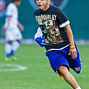 An unidentified man with a Bob Marley shirt is seen running on the field during Panama and EL Salvador concacaf gold cup quarterfinals Sunday, June 19, 2011 at RFK Stadium in Washington DC.
