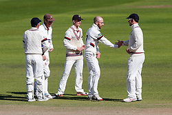 Jack Leach of Somerset (2R) celebrates after bowling out Laurie Evans of Warwickshire for 73 - Mandatory byline: Rogan Thomson/JMP - 07966 386802 - 24/09/2015 - CRICKET - The County Ground - Taunton, England - Somerset v Warwickshire - Day 3 - LV= County Championship Division One.