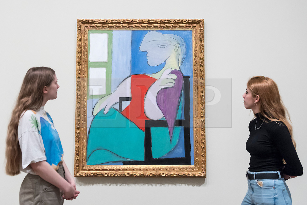 """© Licensed to London News Pictures. 06/03/2018. LONDON, UK.  Staff members view """"Seated Woman by a Window (""""Femme assise pres d'une fenetre""""), 1932, by Pablo Picasso. Preview of """"Picasso 1932 - Love, Fame, Tragedy"""", the Tate Modern's first ever solo exhibition of the work of Pablo Picasso.   More than 100 paintings, sculptures and works on paper covering the year 1932, a pivotal time in Picasso's life, are on display 8 March to 9 September 2018. Photo credit: Stephen Chung/LNP"""