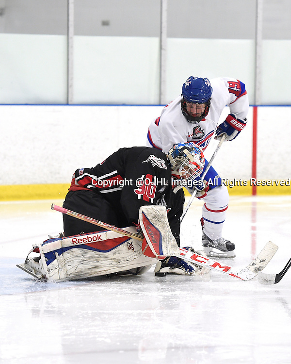 TORONTO, - Feb 21, 2016 -  Ontario Junior Hockey League game action between Mississauga and Toronto at the Scotiabank Pond, ON. Andrew Cipollone #30 of the Mississauga Chargers keeps the puck from Adam Deluca #19 of the Toronto Jr. Canadiens during the second period.<br /> (Photo by Andy Corneau / OJHL Images)