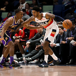 Mar 31, 2019; New Orleans, LA, USA; New Orleans Pelicans guard Elfrid Payton (4) is defended by Los Angeles Lakers gaurd Rajon Rondo (9) during the first quarter at the Smoothie King Center. Mandatory Credit: Derick E. Hingle-USA TODAY Sports