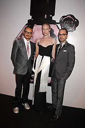 Left to right, designer ROLF SNOEREN, model JADE PARFITT and VIKTOR HORSTING (Designers VIKTOR & ROLF) at the opening of 'The House of Viktor & Rolf' an exhibtion of designs by Viktor & Rolf held at The Barbican Art Gallery, Silk Sytreet, London on 17th June 2008.<br />