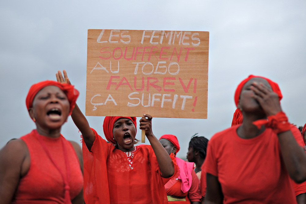 LOME, TOGO - 12-09-20   -  Approximately 300 women dressed in red marched through the Togolese capital city of Lomé on Thursday, September 20 as part of a protest organized by the opposition coalitions Lets Save Togo (Collectif Sauvons le Togo, CST) and Coalition ARC-EN-CIEL.  Several thousand men and youths joined the women in the peaceful march, which ended at an opposition rally point.  Photo by Daniel Hayduk/ AFP