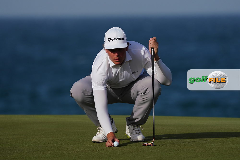 Sami Valimaki (FIN) lines up his putt on the 18th during Round 4 of the Oman Open 2020 at the Al Mouj Golf Club, Muscat, Oman . 01/03/2020<br /> Picture: Golffile | Thos Caffrey<br /> <br /> <br /> All photo usage must carry mandatory copyright credit (© Golffile | Thos Caffrey)
