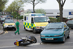 Emergency service workers attending road traffic accident,