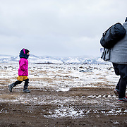In subfreezing snowy weather, refugees walk the unofficial refugee route, near Miratovac, Serbia, January 2016. During the winter of 2016 entry into the Balkans was limited to refugees from Afghanistan, Iraq, and Syria. The typical journey went like this: flee their home country, take a perilous raft ride from Turkey to Greece, and then move onward through foreign lands in search of a peaceful home. The Balkan borders closed to all refugees in March 2016.