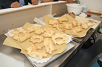 decorated bread shapes on couter in a fair for sale, Sardinian bread sculpture, the Pani Pintau