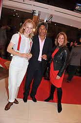 Left to right, HATTIE GALLAGHER, DES GUNEWARDENA and his wife LIZ at an exhibition at The Conran Shop entitled Red to celebrate 25 years of The Conran Shop at the Michelin Building, 81 Fulham Road, London on 19th September 2012.