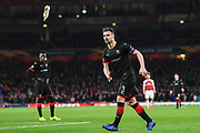 Rennes Damien Da Silva (3) throws a bottle off the pitch that had been thrown on by the Rennes fans during the Europa League round of 16, leg 2 of 2 match between Arsenal and Rennes at the Emirates Stadium, London, England on 14 March 2019.