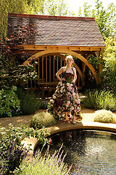 Th 2010 Royal Horticultural Society Chelsea Flower show in the grounds of Royal Hospital Chelsea, London on 24th May 2010.<br /> <br /> Picture shows:- Model in the M&G investments garden