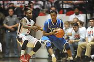 "Kentucky's Ryan Harrow (12) vs. Ole Miss' Derrick Millinghaus (3) at the C.M. ""Tad"" Smith Coliseum on Tuesday, January 29, 2013.  (AP Photo/Oxford Eagle, Bruce Newman).."