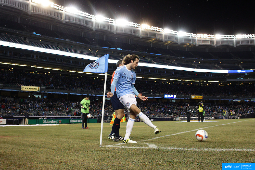 Mix Diskerud, NYCFC, takes a corner during the New York City FC Vs Sporting Kansas City, MSL regular season football match at Yankee Stadium, The Bronx, New York,  USA. 27th March 2015. Photo Tim Clayton