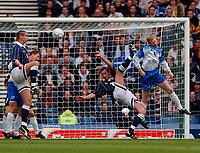 Photo. Richard Lane<br />Scotland v Iceland. Euro 2004 Qualifying Match at Hampden Park. 29/03/2003.<br />Don Hutchison gets an over head shot in as Brynar Gunnarsson challenges.