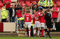 Fotball<br /> England 2005/2006<br /> Foto: SBI/Digitalsport<br /> NORWAY ONLY<br /> <br /> Swindon v Yeovil<br /> Coca Cola League 1.<br /> 27/08/2005.<br /> <br /> Swindon's Christian Roberts celebrates his scoring the fourth Swindon goal with his team mates.