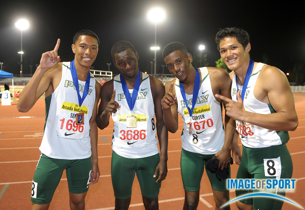 Apr 7, 2012; Arcadia, CA, USA; Members of the Long Beach Poly boys 4 x 400 relay pose after winning in 3:18.55 in the Arcadia Invitational at Arcadia High. From left: Veng Seth and Rick Smith and Austin Gunter and Colin Monaco.