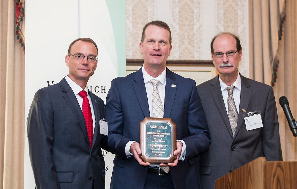 Craig Butler, left, John Born and Mark Weinberg pose for a photo with Born's Outstanding State Government Alumnus Award during the Ohio University State Government Alumni Luncheon on Tuesday, May 5, 2015.  Photo by Ohio University  /  Rob Hardin