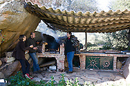 Corsica. France. friend near the traditional oven . at Mr Preziosi Beekeeper house  in Tradicetto  Corsica south  France    / Mr Preziosi Apiculteur a tradicetto, gite habitat traditionel en pierre  Corse du sud  France  /