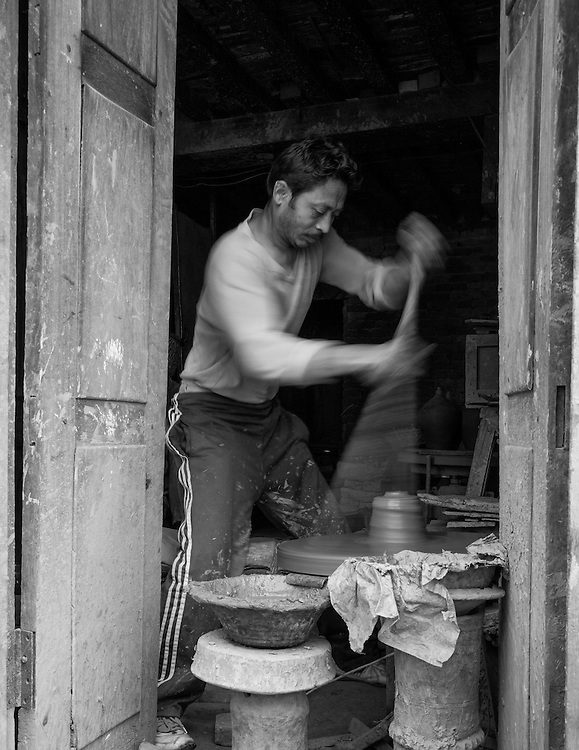 A potter in Bhaktapur, Nepal practicing his trade