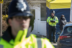 © Licensed to London News Pictures. 08/03/2018. Salisbury, UK. Police stand outside the house of Sergei Skripal as they prepare to search his home. Former Russian spy Sergei Skripal, his daughter Yulia and a policeman are still critically ill after being poisoned with nerve agent. The couple where found unconscious on bench in Salisbury shopping centre. Authorities continue to investigate. Photo credit: Peter Macdiarmid/LNP
