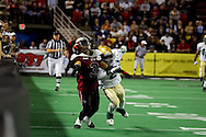 4/12/2007 - Thomas Ford, Jr. (3) of the Alaska Wild stretches out for a pass as Frisco Thunder defender, Jamaal Denmon (2) plays tight defense.  Denmon would be called for pass interference, but his team would go on to beat the Wild 46-33 in the first professional football game in Alaska.