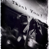 Old typewriter close up on keys, typing thank you. Distressed old Polaroid Type 55