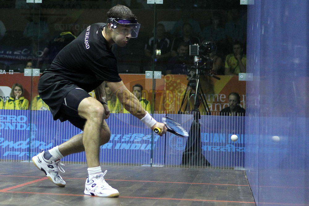 Martin Knight of New Zealand during the final of the mixed doubles squash competition held at the Siri Fort Complex in New Delhi as part of the XIX Commonwealth Games, India on the 13 October 2010..Photo by:  Ron Gaunt/photosport.co.nz
