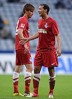 Fussball 2. Bundesliga:  Saison   2012/2013,    4. Spieltag  TSV 1860 Muenchen - MSV Duisburg    31.08.2012 Dustin Bomheuer und Tanju Oeztuerk (v. li., MSV Duisburg)