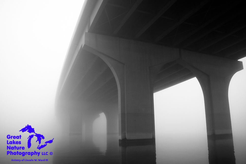 In this image, a mighty structure, the Allouez-Ashwaubenon Bridge, which carries Wisconsin Highway 172 over the Fox River, appears to emerge from very mysterious origins.