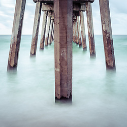 Pensacola Beach Gulf Pier pillars and Gulf of Mexico photo. Pensacola Beach is on Santa Rosa Island in the Southeastern United States of America. Copyright ⓒ 2018 Paul Velgos with All Rights Reserved.