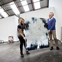 Nederland, Amsterdam , 9 januari 2014.<br /> Kunstenaar Rene Jolink en Manuela Klerkx van klerx International Art Management tijdens het inrichten van de solo expositie getiteld, Verzonken Beelden,<br /> bij galerie Vous etes Ici in Amsterdam Noord.<br /> <br /> VOUS ETES ICI en Klerkx International Art Management verheugen zich in het feit dat René Jolink, na een periode van afwezigheid, terug is met een indrukwekkende serie nieuwe schilderijen die van 12 januari tot en met 8 februari 2014 zullen worden getoond bij VOUS ETES ICI, in Amsterdam.<br /> <br /> Visual artist Rene Jolink is back with an impressive series of new paintings, after a period of absence, at the exhibition in the gallery VOUS ETES ICI in Amsterdam.