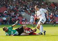 Photo: Leigh Quinnell.<br /> Bournemouth v Swansea City. Coca Cola League 1. 14/10/2007. Swanseas Warren Feeney scores his teams fourth goal past Bournemouths 'keeper Neil Moss and defender Shaun Cooper.