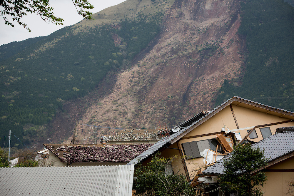 KUMAMOTO, JAPAN - APRIL 18:  A collapsed house is seen with landslide background on April 18, 2016 in Minamiaso, Kumamoto, Japan. The magnitude 7.3 earthquake hit Kyushu, just after the earthquake killed 9, at least 26 new fatalities by this earthquake, total death toll from the series of earthquake rises to 42.