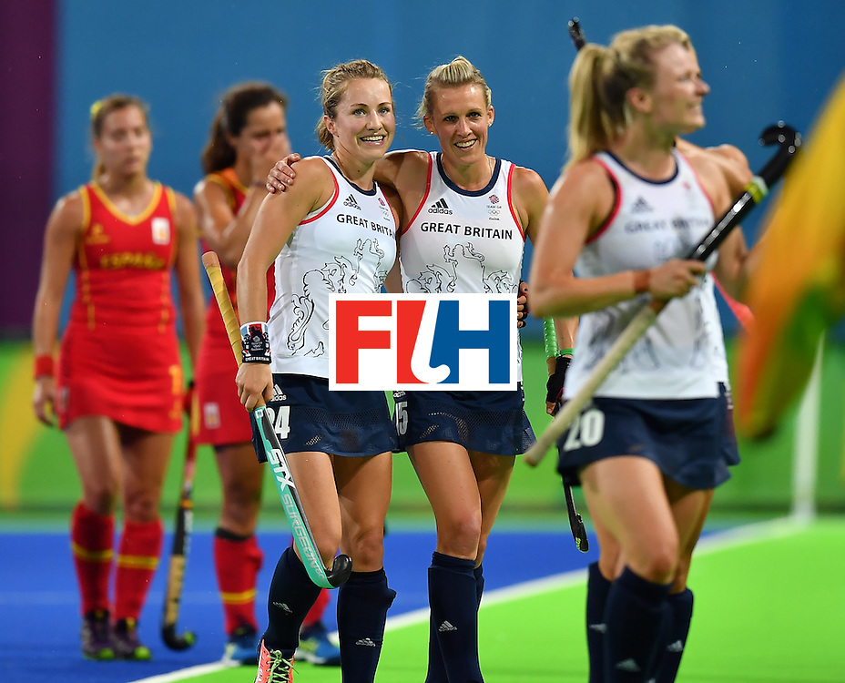 Britain's Shona McCallin and Britain's Alex Danson (C R) leave the pitch after the women's quarterfinal field hockey Britain vs Spain match of the Rio 2016 Olympics Games at the Olympic Hockey Centre in Rio de Janeiro on August 15, 2016. / AFP / MANAN VATSYAYANA        (Photo credit should read MANAN VATSYAYANA/AFP/Getty Images)