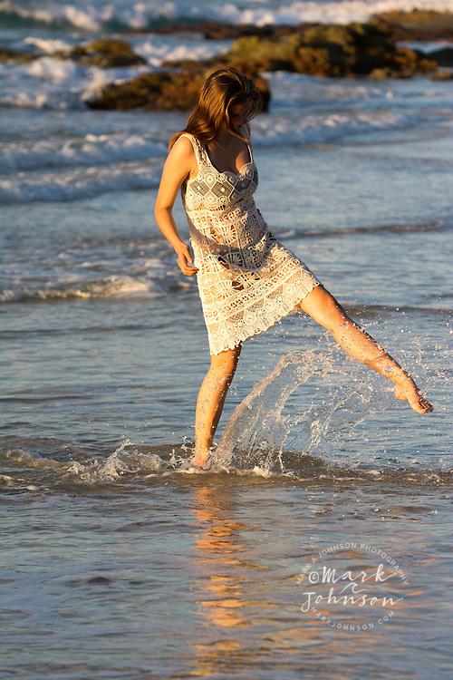 Young woman in a sun dress on a beach, N. Stradbroke Island, Queensland, Australia