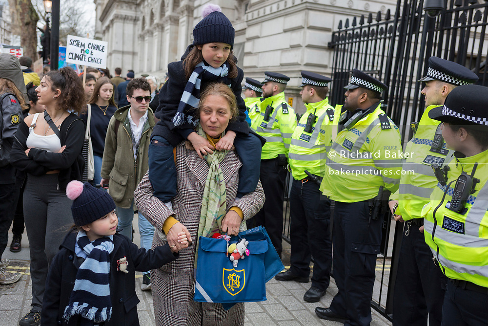 Inspired by Swedish teenager Greta Thunberg and organised by Youth Strike 4 Climate, British eco-aware school and college-age pupils protest about Climate Change inaction outside Downing Street in Whitehall during their walkout from classes, on 15th March 2019, in Westminster, London England.