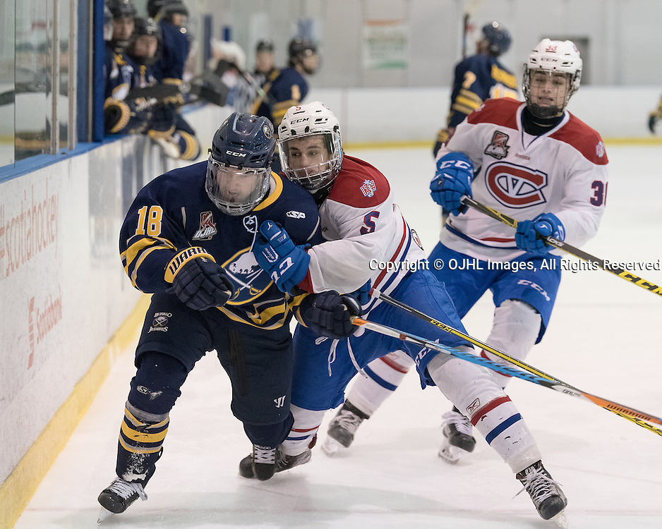 KINGSTON, ON - FEB 16,  2017: Ontario Junior Hockey League game between Buffalo Junior Sabres and Kingston Voyageurs, Anthony Firriolo #5 of the Kingston Voyageurs makes the hit on Cameron Radziwon #18 of the Buffalo Jr. Sabres during the second period.<br /> (Photo by Ian Dixon/ OJHL Images)