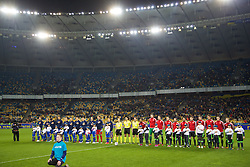 KIEV, UKRAINE - Easter Monday, March 28, 2016: Wales and Ukraine players line-up before the International Friendly match at the NSK Olimpiyskyi Stadium. (Pic by David Rawcliffe/Propaganda)
