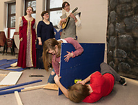 """Princess 12"" Emma Lacey, ""Winifred"" Kelly Hayes and ""The Minstral"" Ian Cluett serenade Noel Murphy and Gabe Fraser as they build set pieces for Once Upon a Mattress during ""Tech Day"" at Belmont High School Saturday morning.  (Karen Bobotas/for the Laconia Daily Sun)"