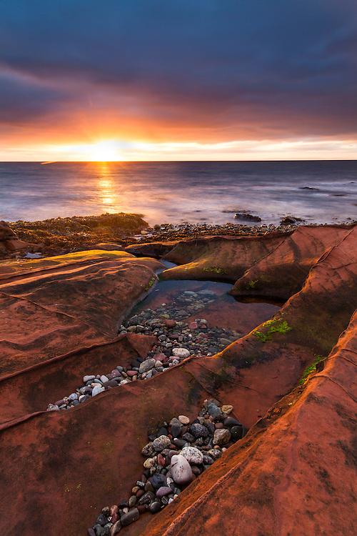 Sandstone rocks at sunrise, Corrie, Isle of Arran