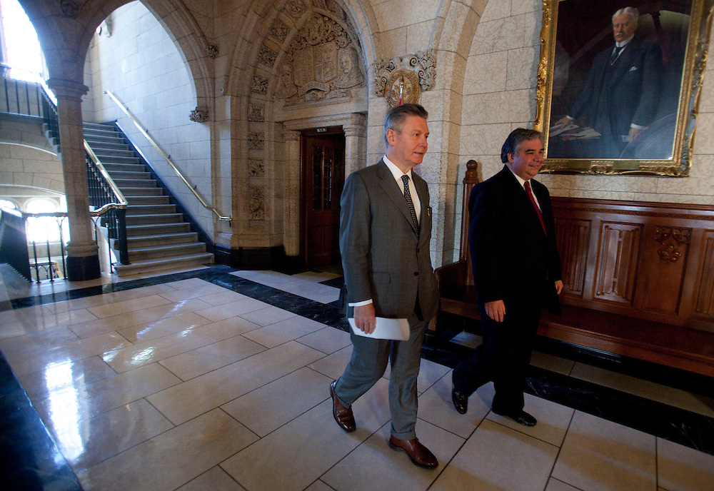 Karel De Gucht, European Commissioner for Trade and Canada's Minister of International Trade Peter Van Loan arrive for a press conference on Parliament Hill in Ottawa, Canada December 15, 2010.<br /> AFP/GEOFF ROBINS/STR
