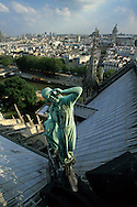 France. Paris elevated view from Notre dame cathedral. Violet Leduc statue. view from the spire of Notre dame cathedral  . The spire dominates the verdigris copper statues of the twelve apostles with the symbols of the four evangelists. Viollet-le-Duc represented himself as Saint Thomas holding a square. He seems to be contemplating the top of his Great Work