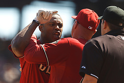 September 4, 2011; San Francisco, CA, USA;  Arizona Diamondbacks right fielder Justin Upton (left) is restrained by manager Kirk Gibson (center) while arguing with MLB umpire Brian Knight (right) after being ejected during the fourth inning against the San Francisco Giants at AT&T Park.