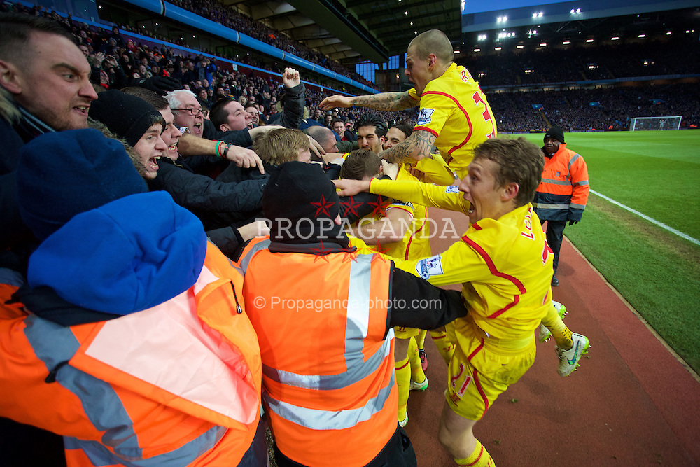 BIRMINGHAM, ENGLAND - Saturday, January 17, 2015: Liverpool's Rickie Lambert [hidden] and team-mates Lucas Leiva and Martin Skrtel celebrate scoring the second goal against Aston Villa with the travelling supporters during the Premier League match at Villa Park. (Pic by David Rawcliffe/Propaganda)