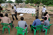 A MAG community liaison team gives Mine Risk Education to people living in an area where a huge number of unexploded ordinance were found scattered across a large, open terrain just opposite John Garang's tomb in Juba while area was being prepared for South Sudan independence ceremonies. The Government of South Sudan called on Mines Advisory Group (MAG) to assist SPLA deminers in an attempt to clear the area and make it safe for the thousands of people and dignitaries who will be attending the declaration of independence on July 9th...Juba, South Sudan. 04/07/2011..Photo © J.B. Russell