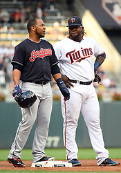 May 31, 2018 - Minneapolis, MN, U.S. - MINNEAPOLIS, MN - MAY 31: Cleveland Indians Designated hitter Edwin Encarnacion (10) and Minnesota Twins Third base Miguel Sano (22) chat at 3rd base between plays during a MLB game between the Minnesota Twins and Cleveland Indians on May 31, 2018 at Target Field in Minneapolis, MN. The Indians defeated the Twins 9-8.(Photo by Nick Wosika/Icon Sportswire) (Credit Image: © Nick Wosika/Icon SMI via ZUMA Press)