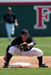 18 April 2010: Michael Stalter gloves a throw from the catcher on a steal attempt.  Southern Illinois Salukis and the Illinois State Redbirds face off on Duffy Bass Field on the campus of Illinois State University in Normal Illinois.
